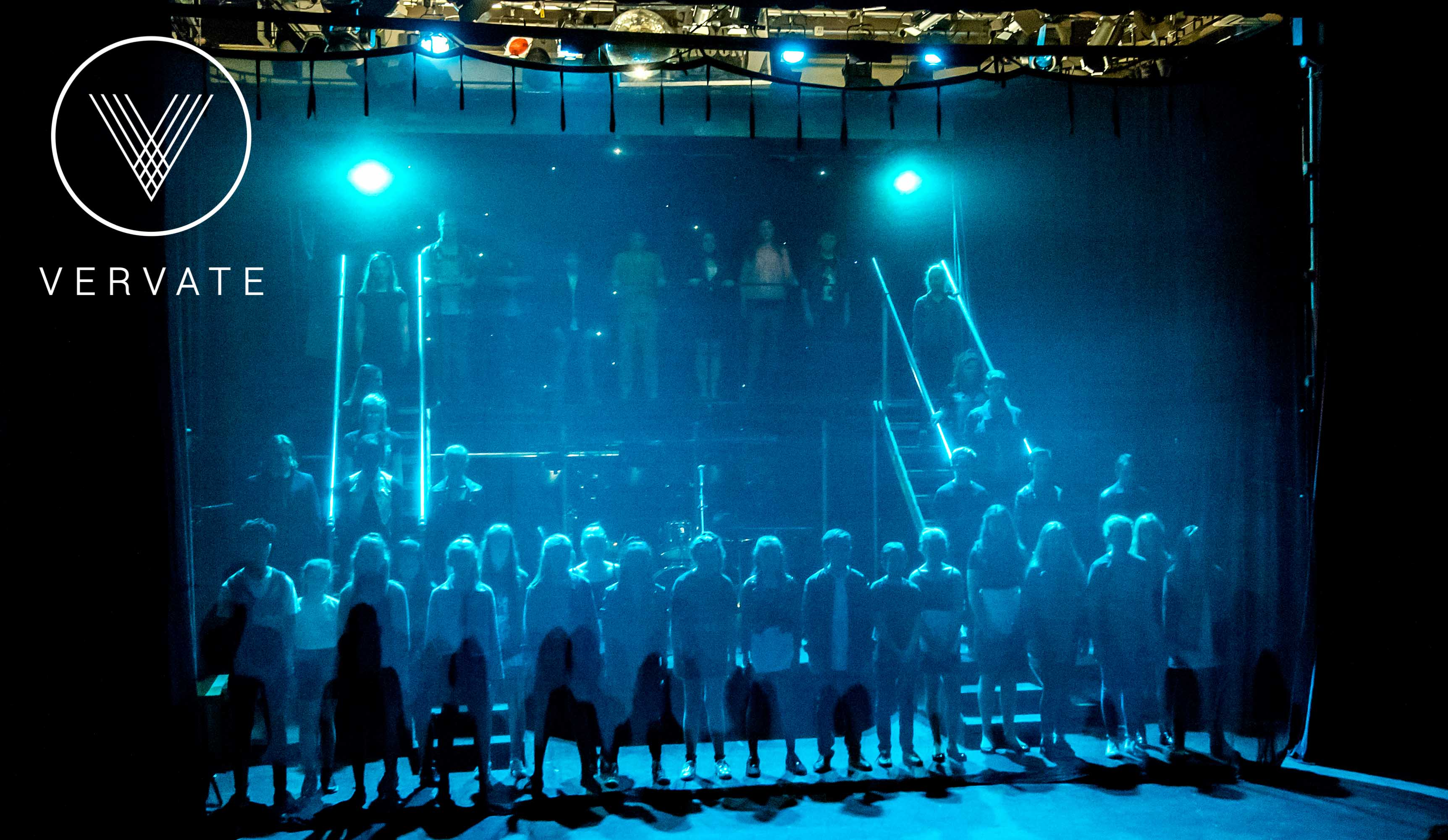 blue light on pupil performers at a school production
